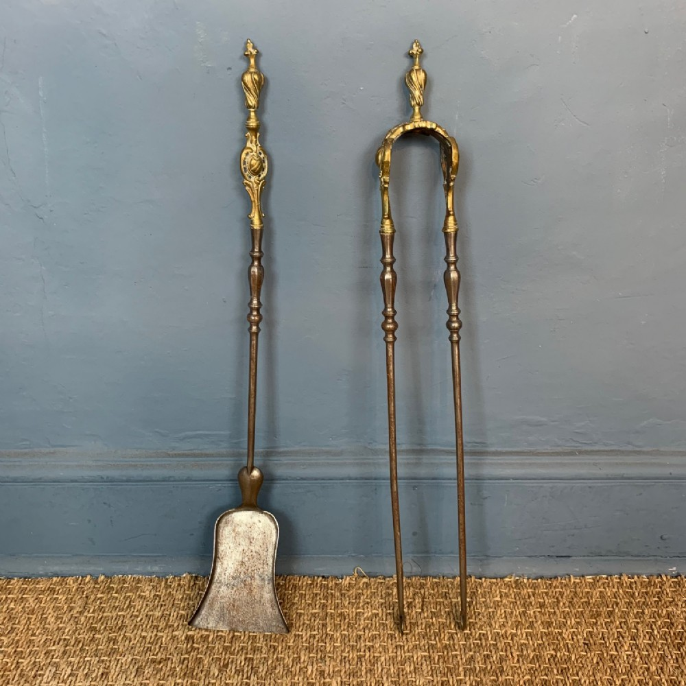 a pair of victorian gothic gilt brass and steel fire irons circa 1870