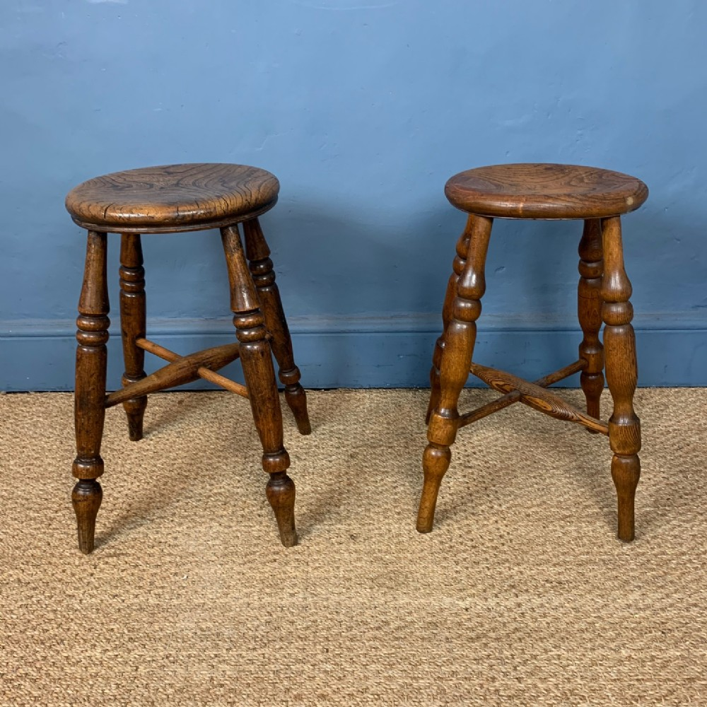a pair of late 19th century elm lincolnshire stools