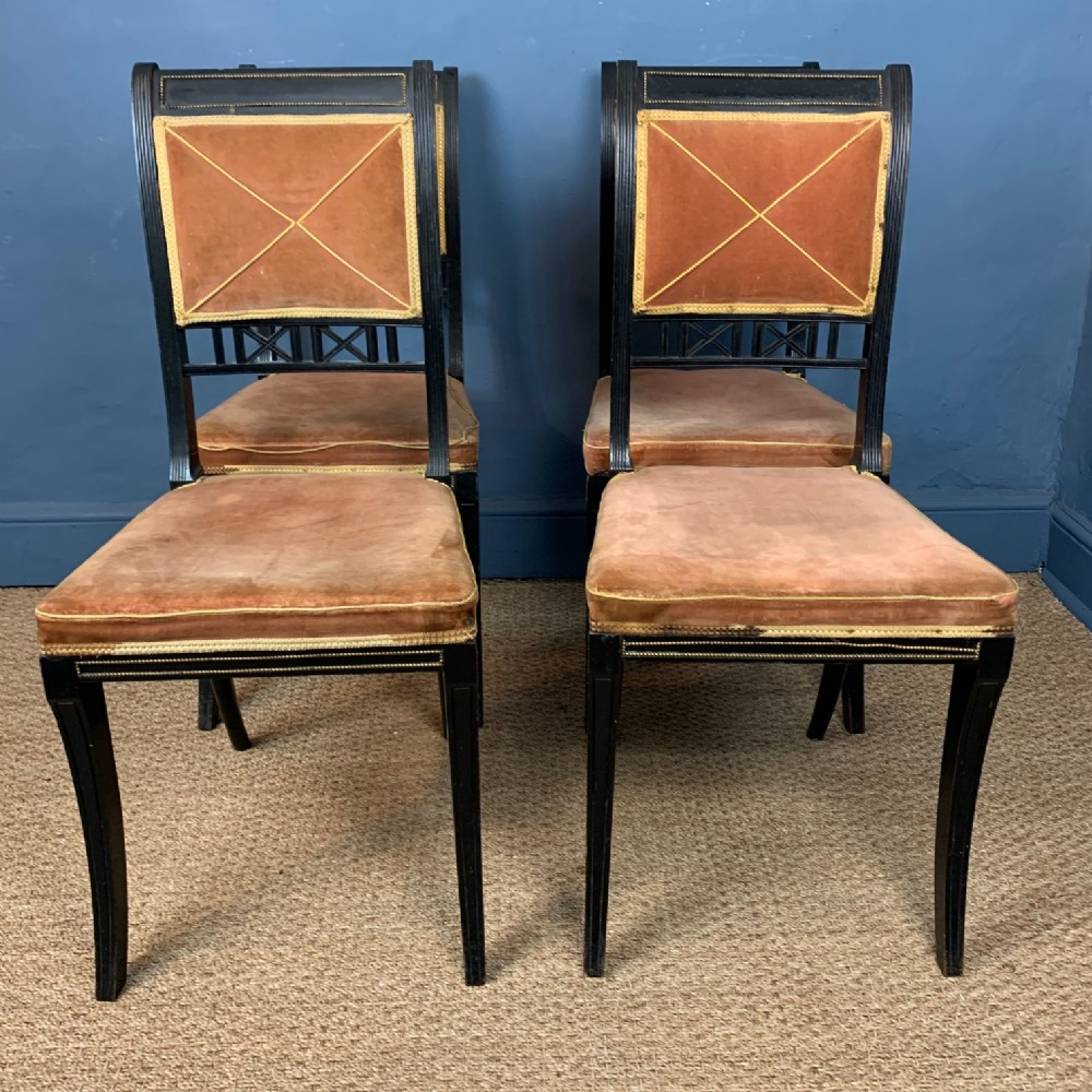 a set of four regency ebonised dining chairs circa 1830