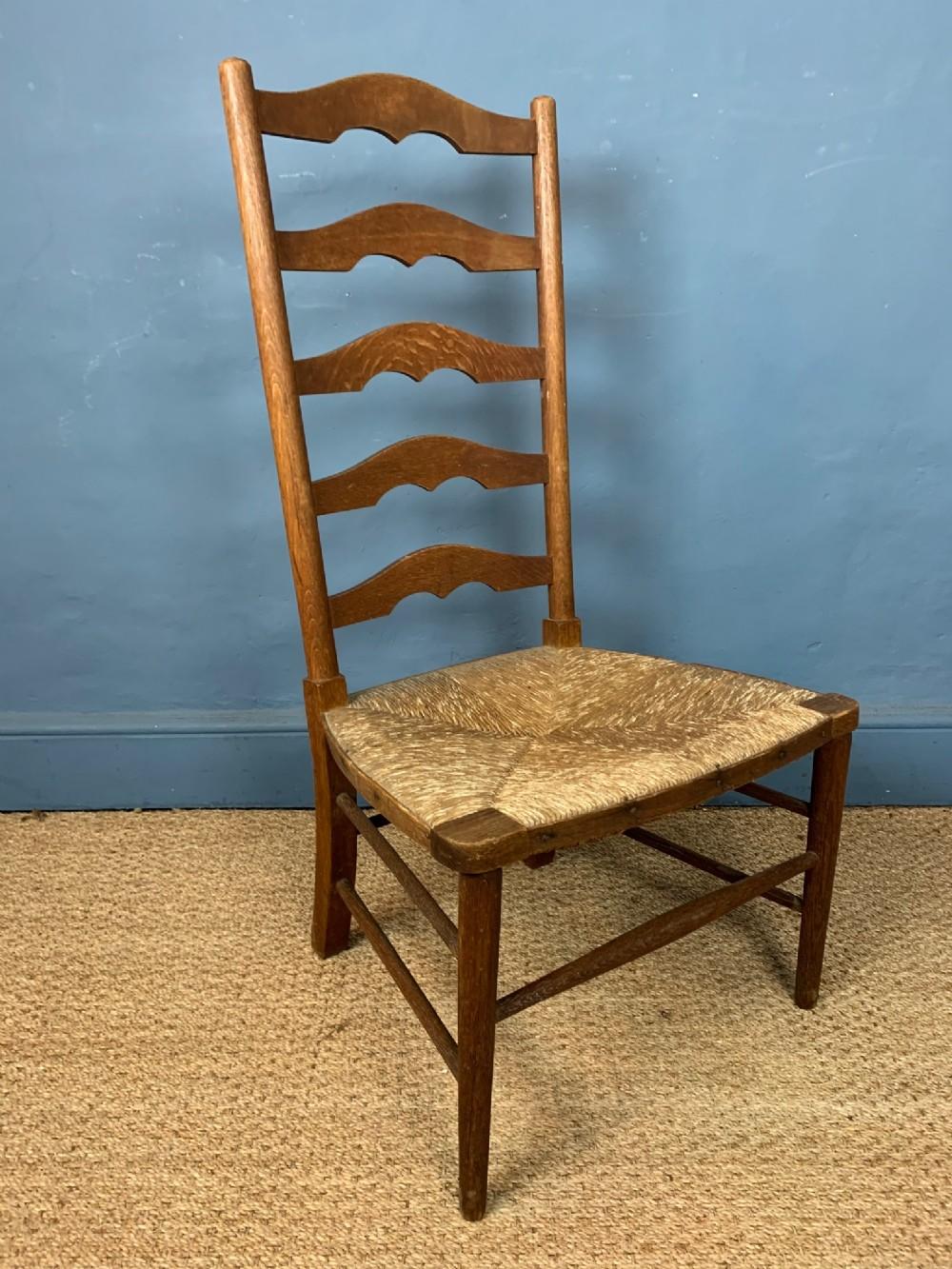 a heals oak rush seated ladder back chair c 1930