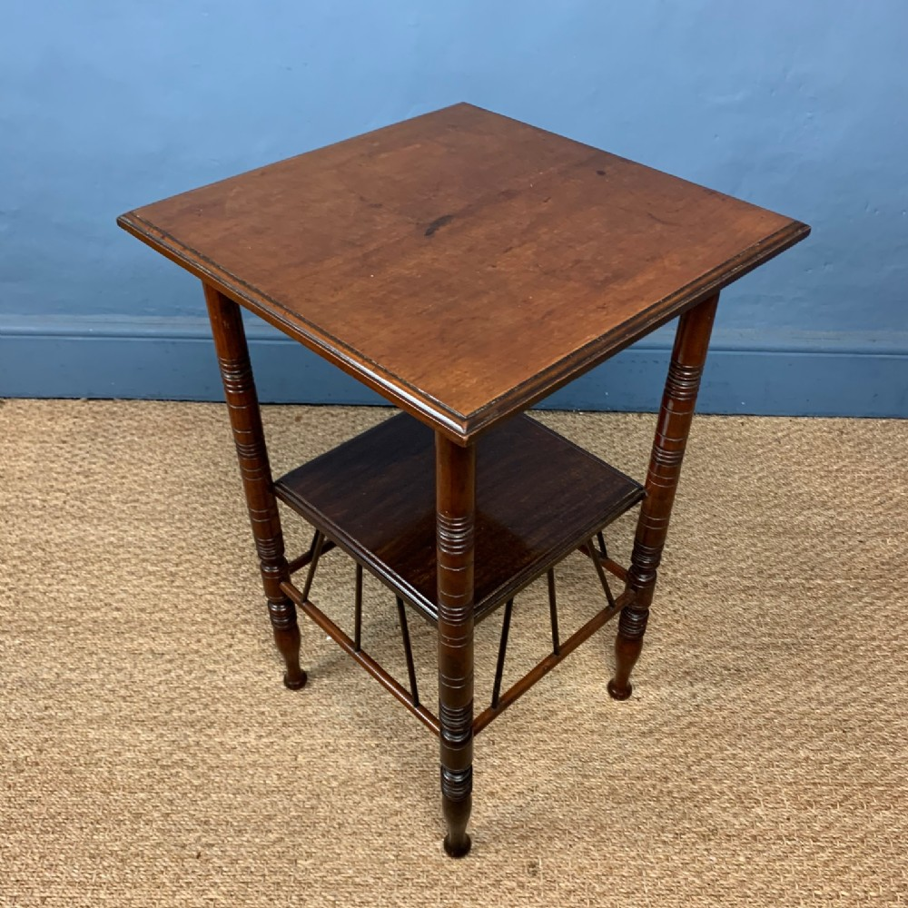 an aesthetic movement walnut twotiered table c 1880 after a design by ew godwin