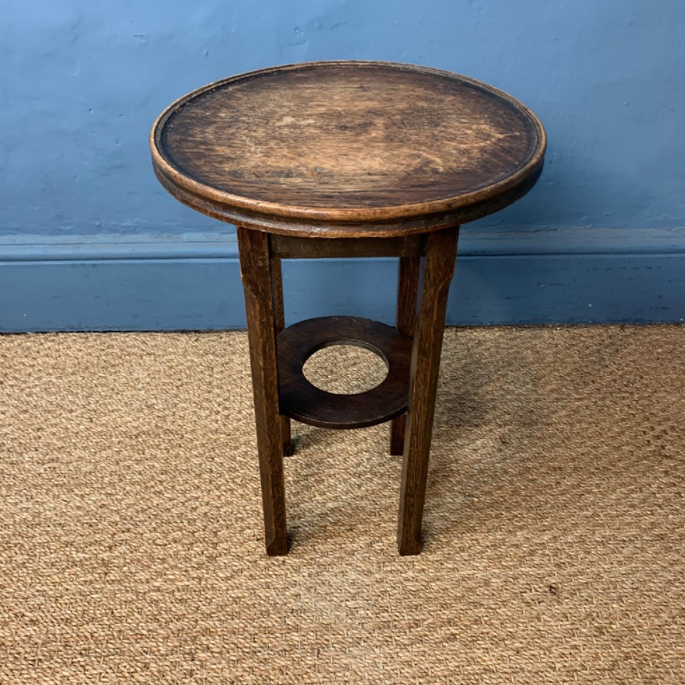 a small arts and crafts fumed oak 2 tier table circa 1910