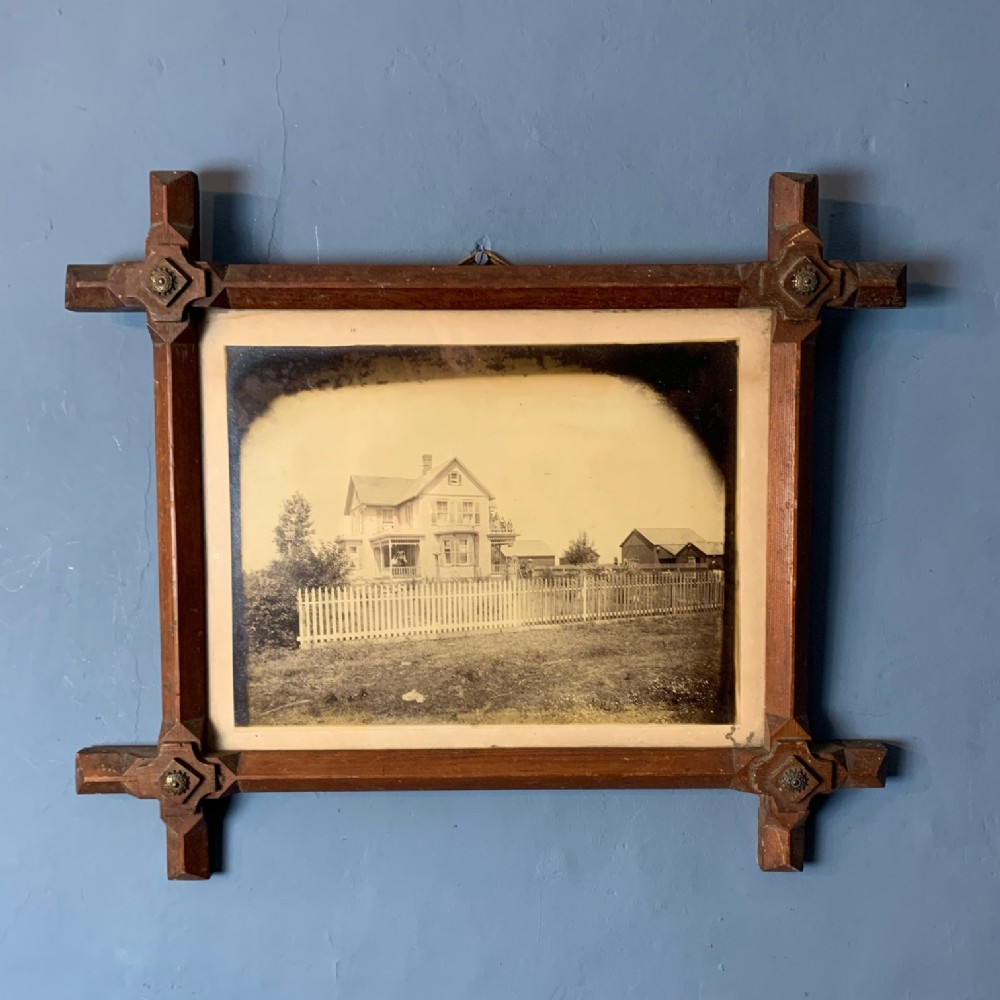 an early american photograph circa 1880 in a tramp art style frame