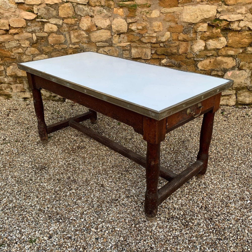 a west country pine enamel and brass banded dairy table circa 1900