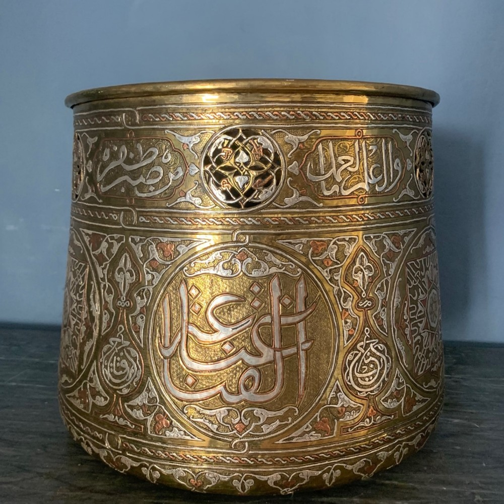 a large cairene brass silver and copper inlaid bowl circa 1900