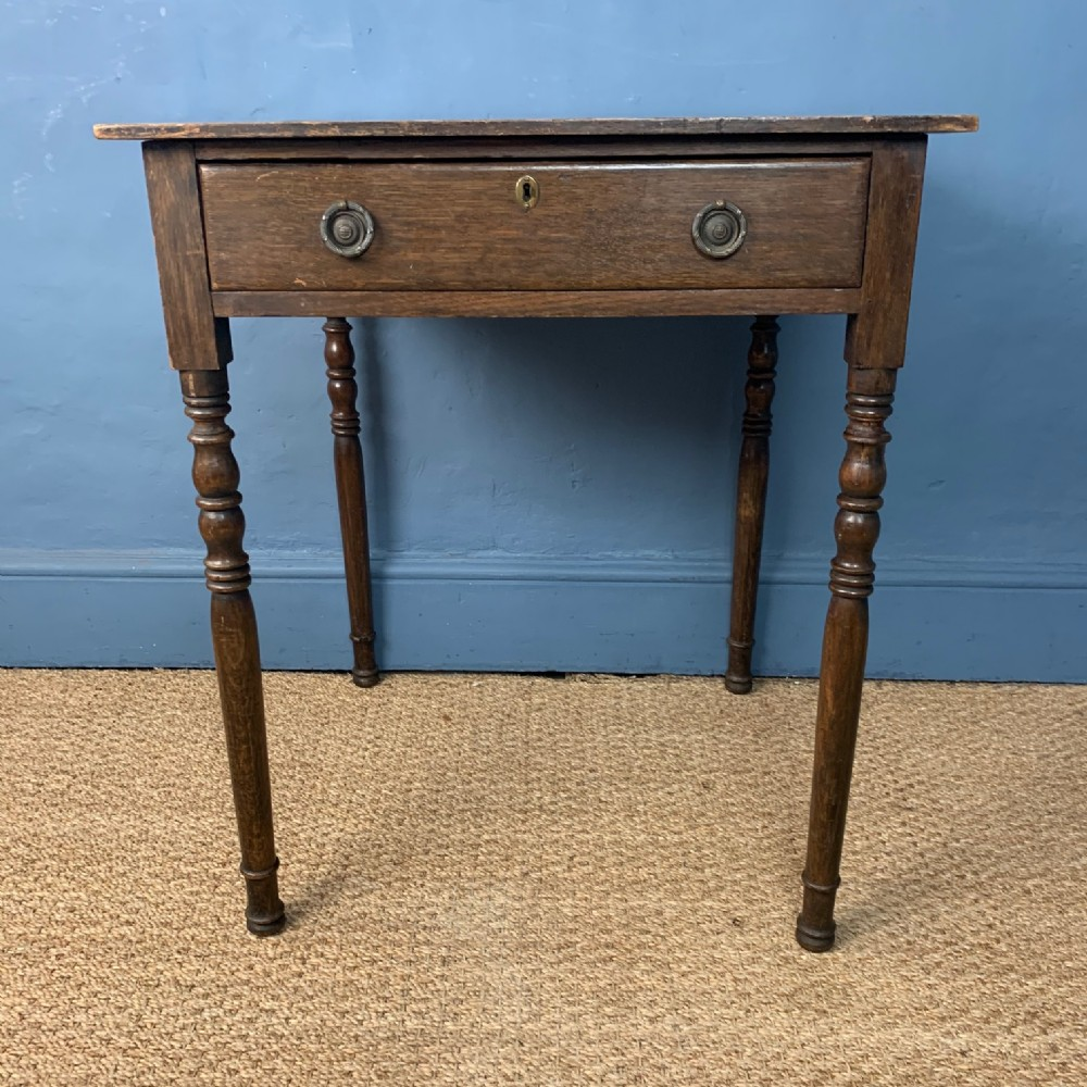 an early 19th century oak side table