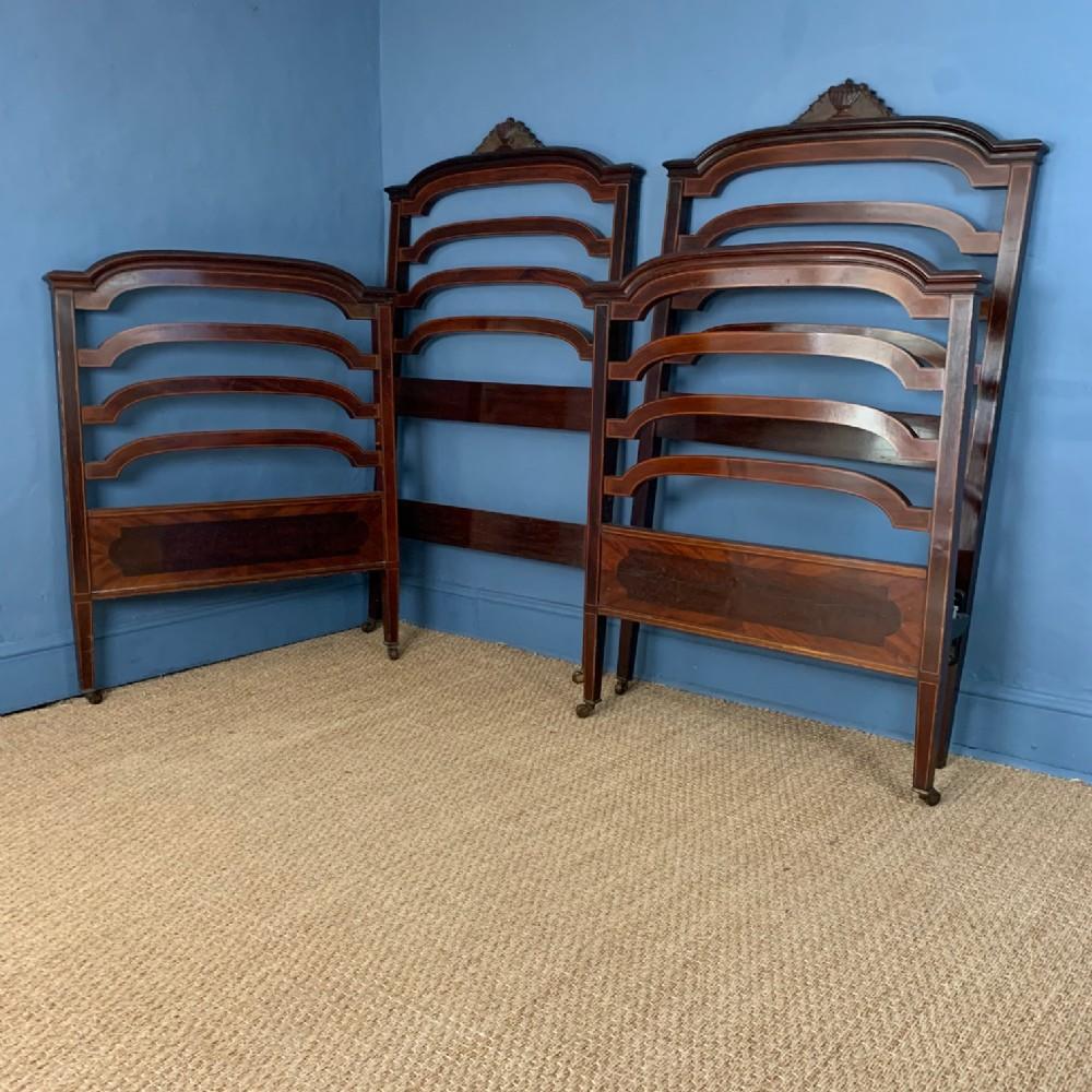 a pair of edwardian mahogany and boxwood strung single beds circa 1910