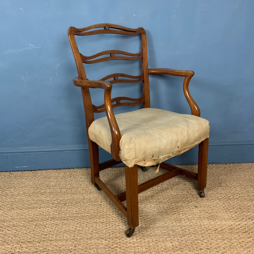 a late 18th century provincial mahogany george 111 ladder back armchair