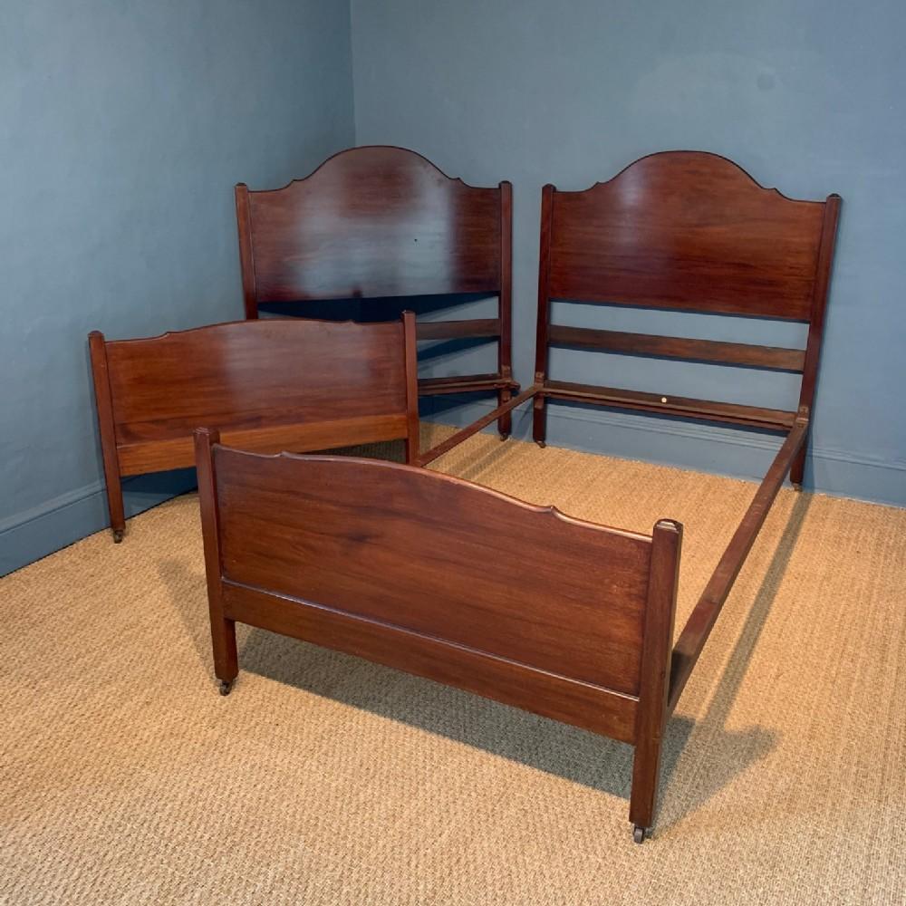 a pair of heals mahogany single beds circa 1925