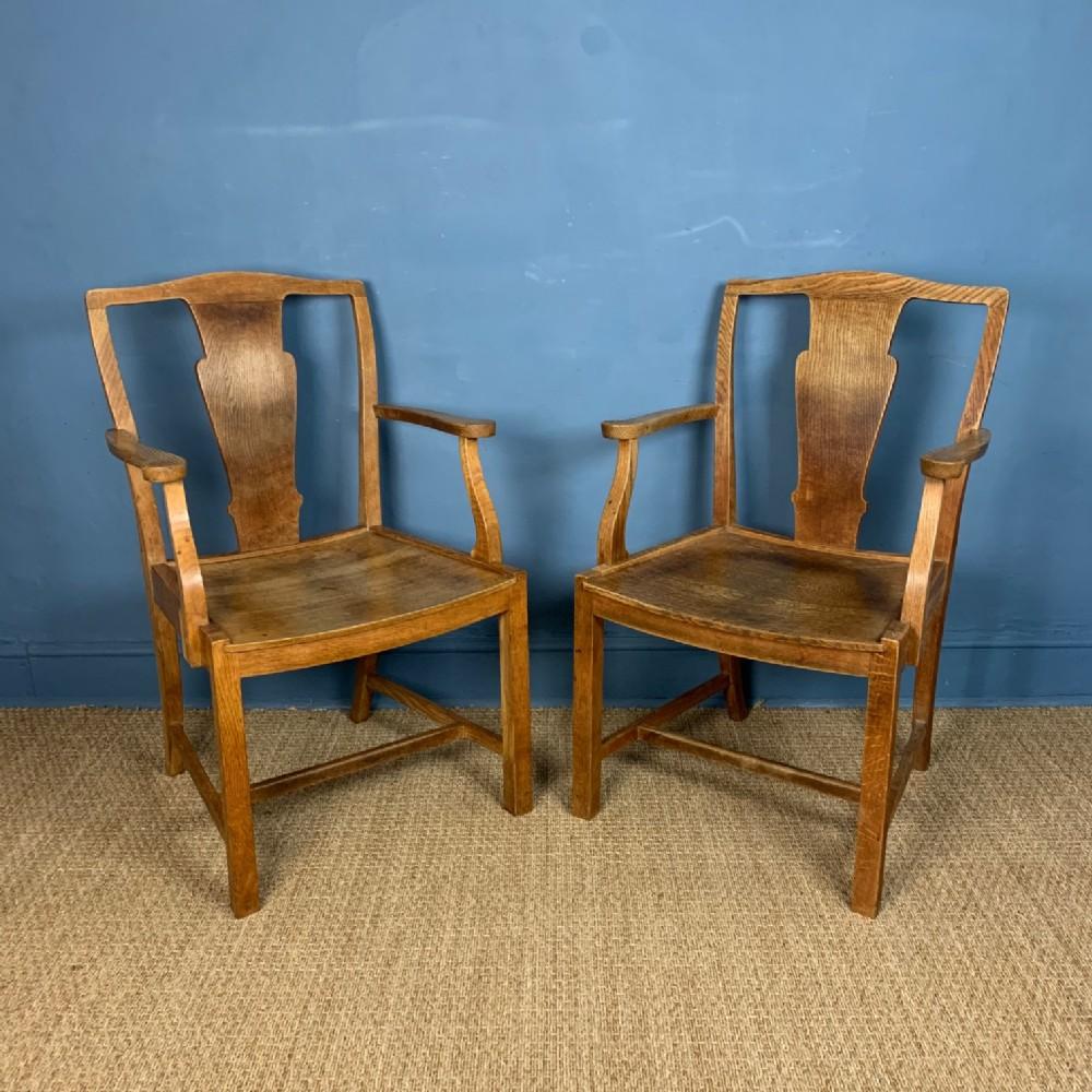 a pair of heals oak armchairs circa 1930