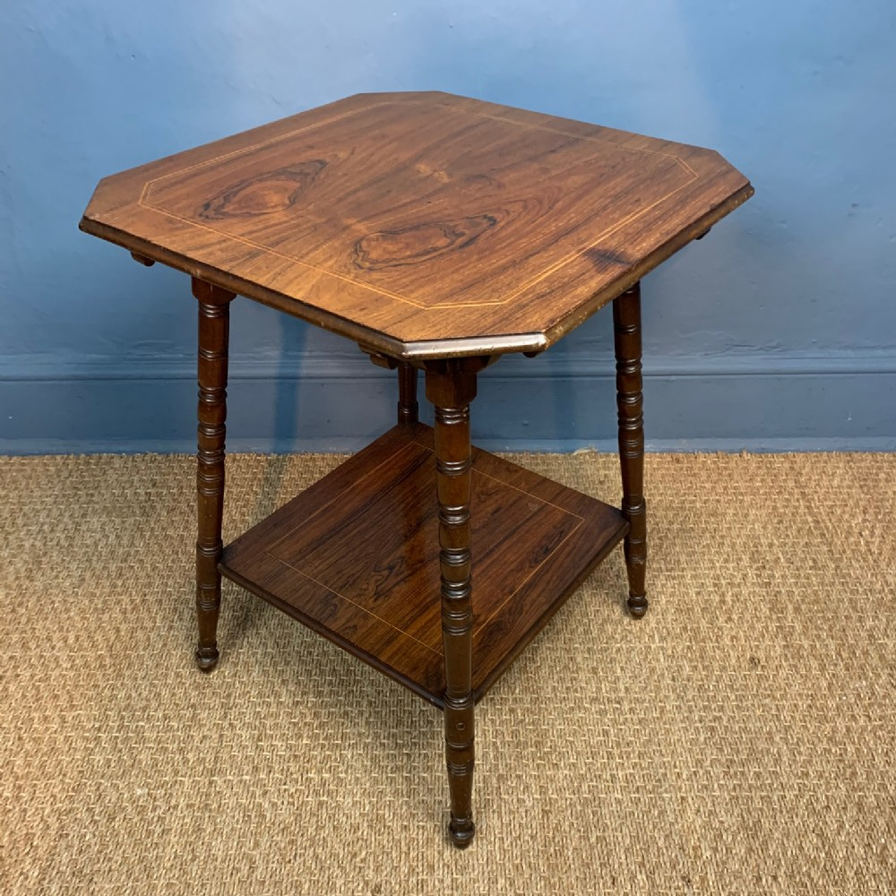 an aesthetic rosewood 2 tier table circa 1890