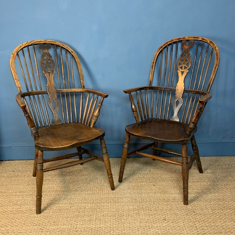 a pair of 19th c ash and elm wheel back high windsor chairs