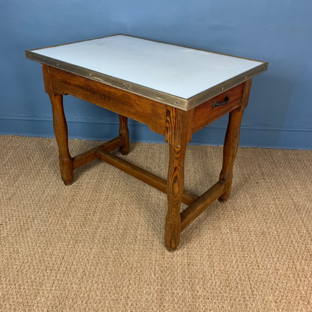 a west country pine enamel and brass banded dairy table circa 1910