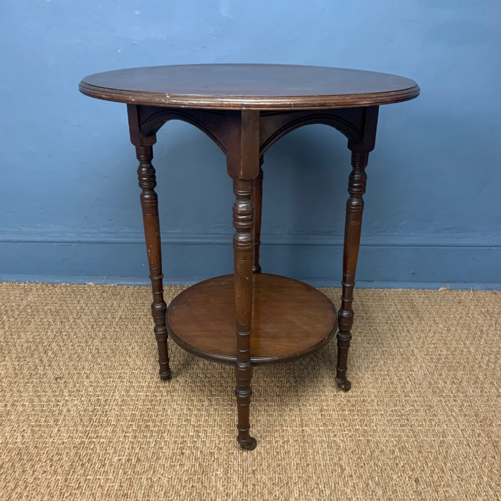 an aesthetic movement mahogany two tiered table circa 1890