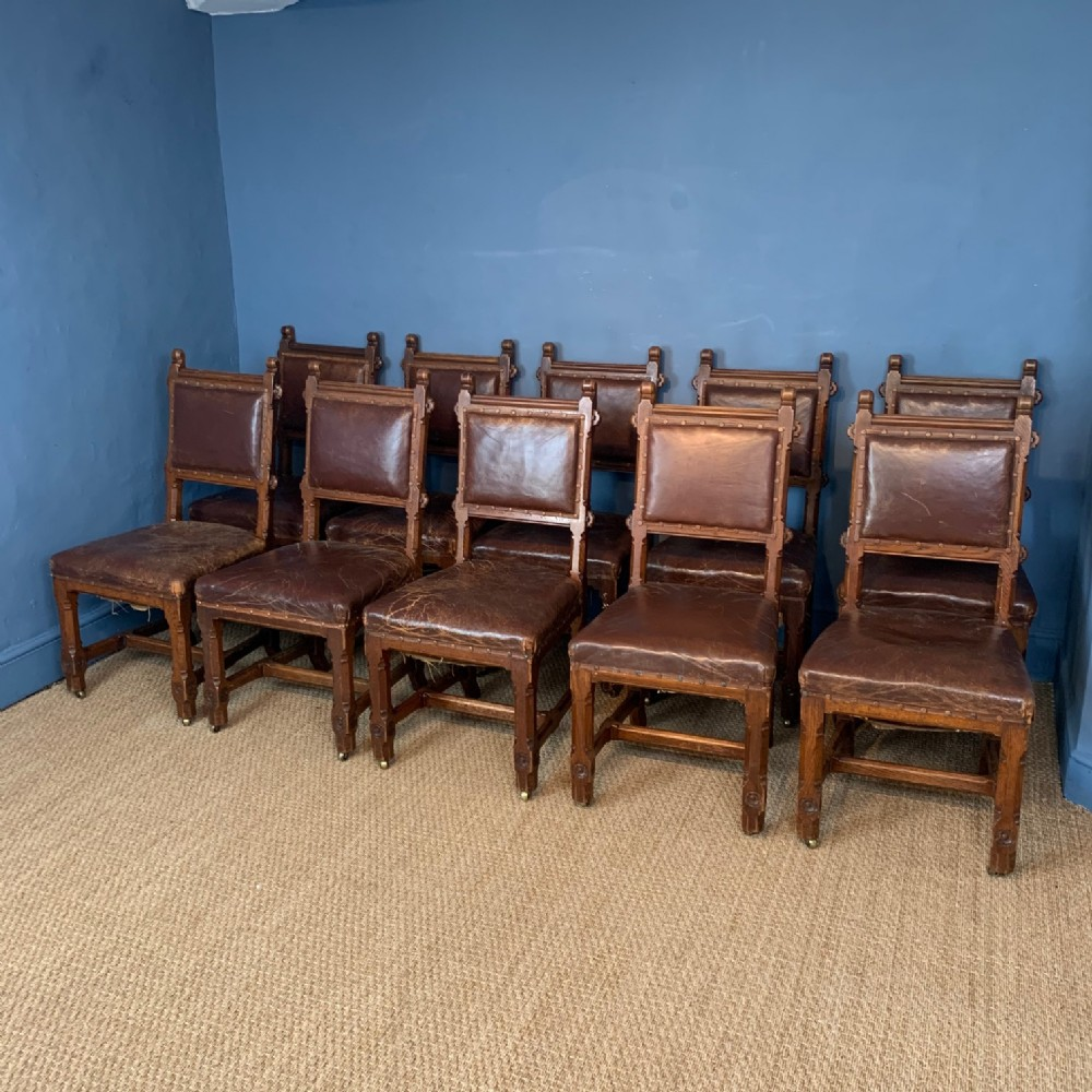 a set of 10 gothic oak and leather dining chairs circa 1870 to a design by a w n pugin