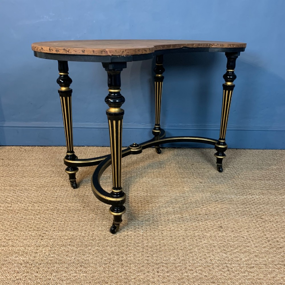 an aesthetic movement ebonised and parcel gilt kidney shaped dressing table circa 1880