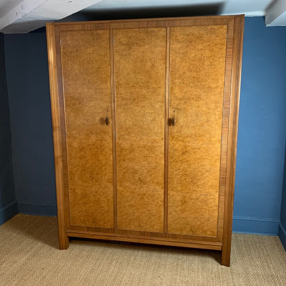 a fine gordon russell burr elm and black walnut compactum wardrobe dated 1937