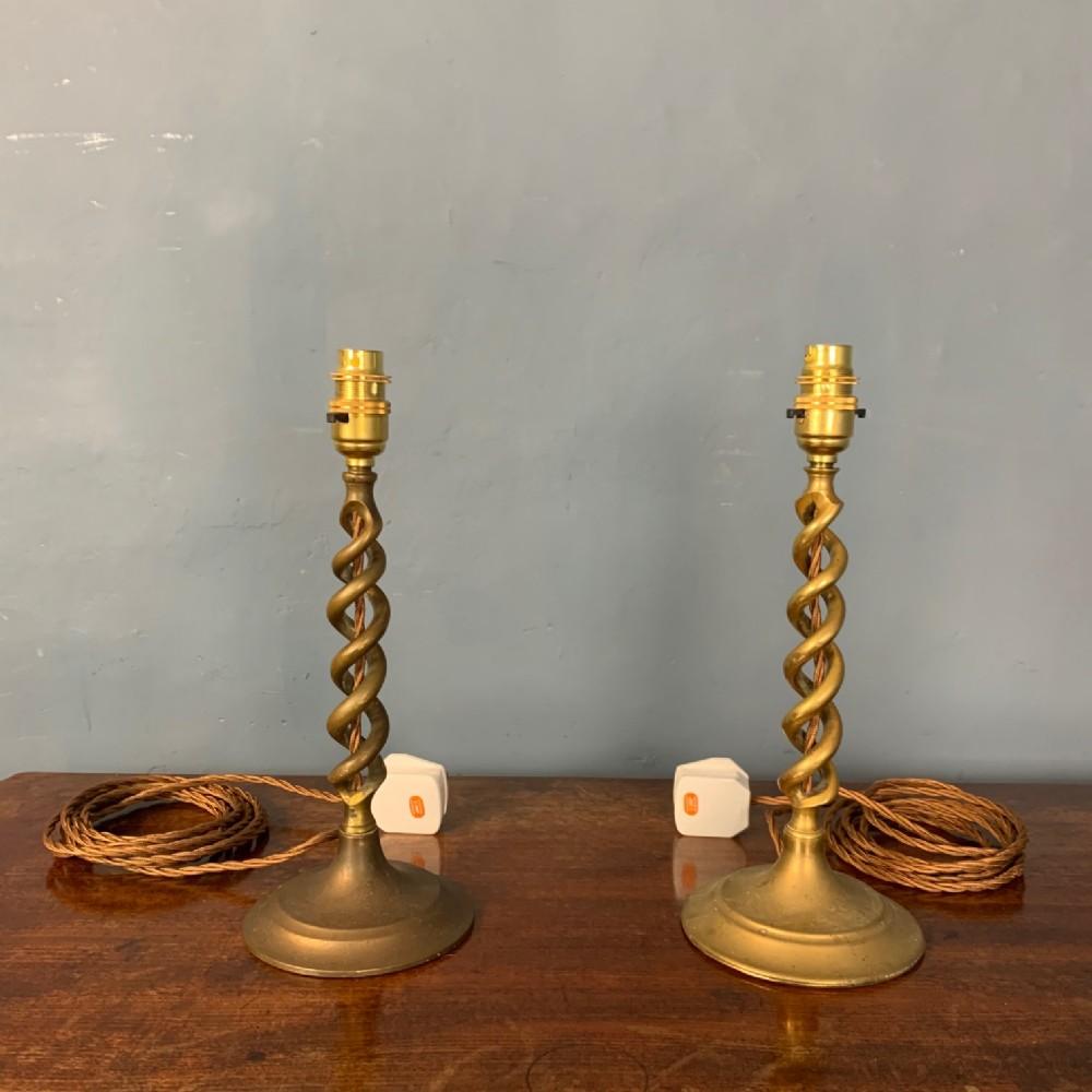 a pair of edwardian brass twist lamps circa 1910