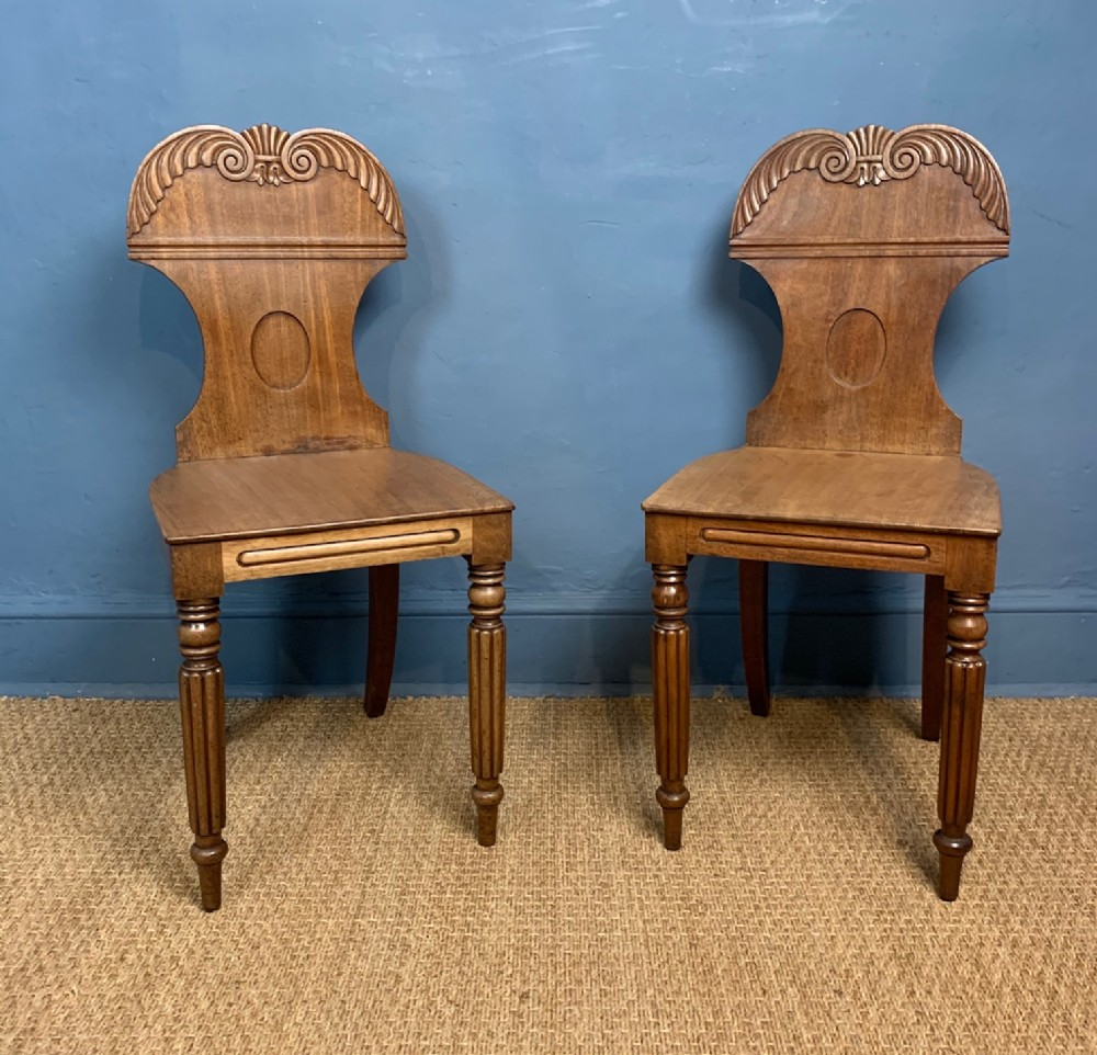 a pair of george 1v faded mahogany hall chairs circa 1825