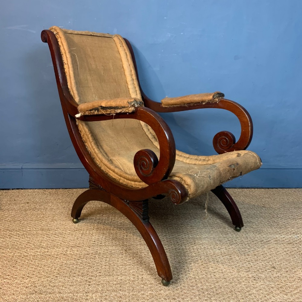 a george 1v mahogany scrolled library armchair circa 1830 after a design by jc loudon