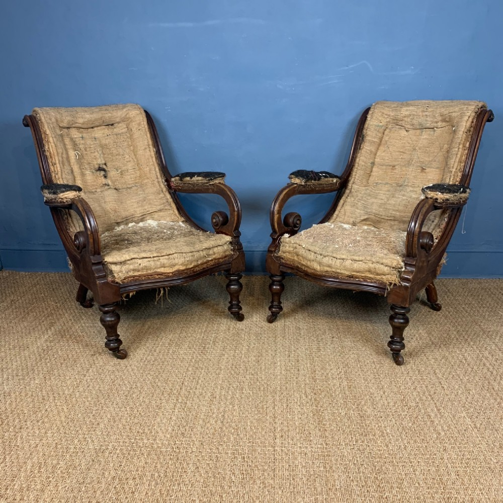 a pair of early victorian scroll back mahogany library chairs circa 1850