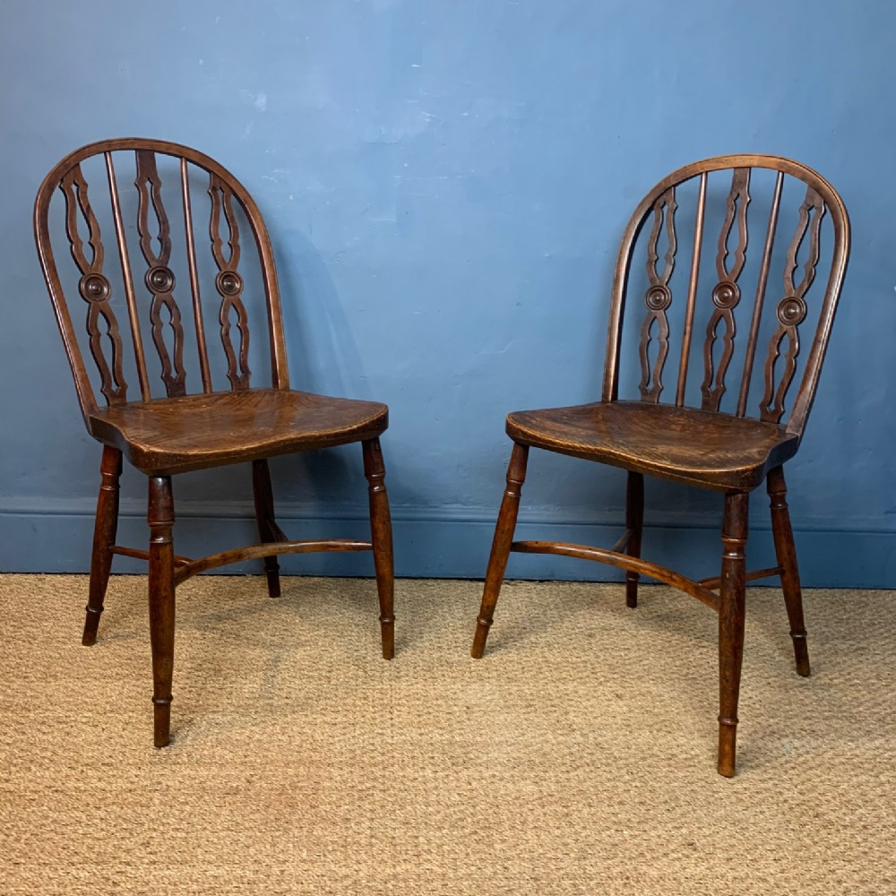a pair of early 19th c yew wood windsor chairs