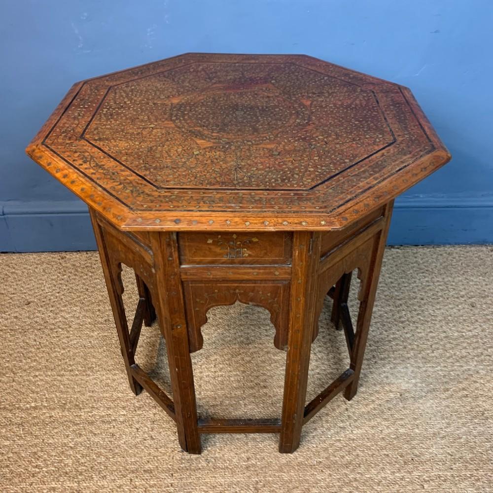 a large hoshiapur octagonal shisham wood brass and ebony inlaid table circa 1900