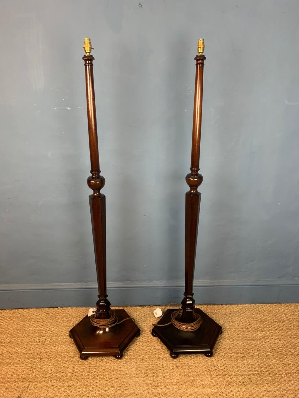 a pair of heals style mahogany standard lamps circa 1920