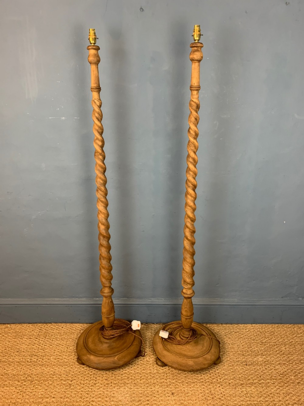 a pair of heals style oak standard lamps circa 1920
