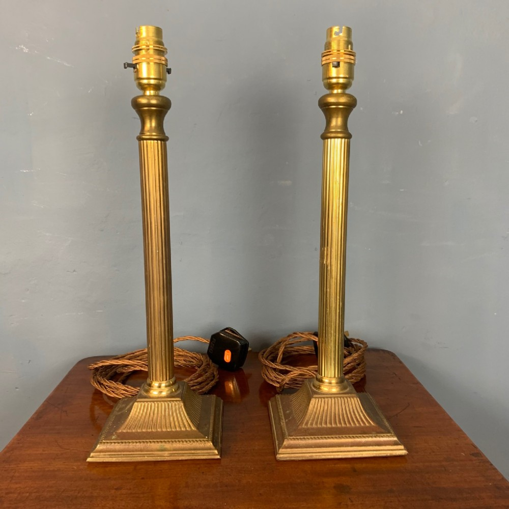 a pair of edwardian brass table lamps circa 1910
