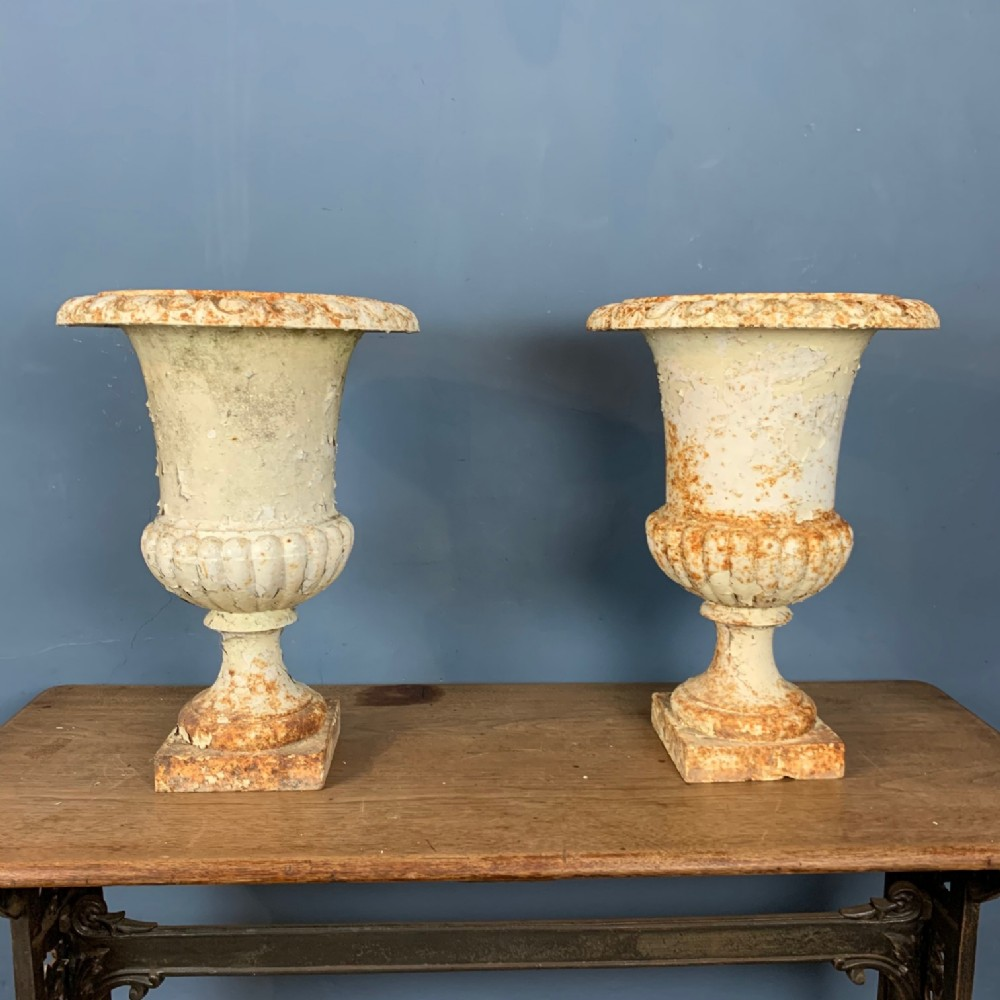 a pair of mid 19th century cast iron garden urns