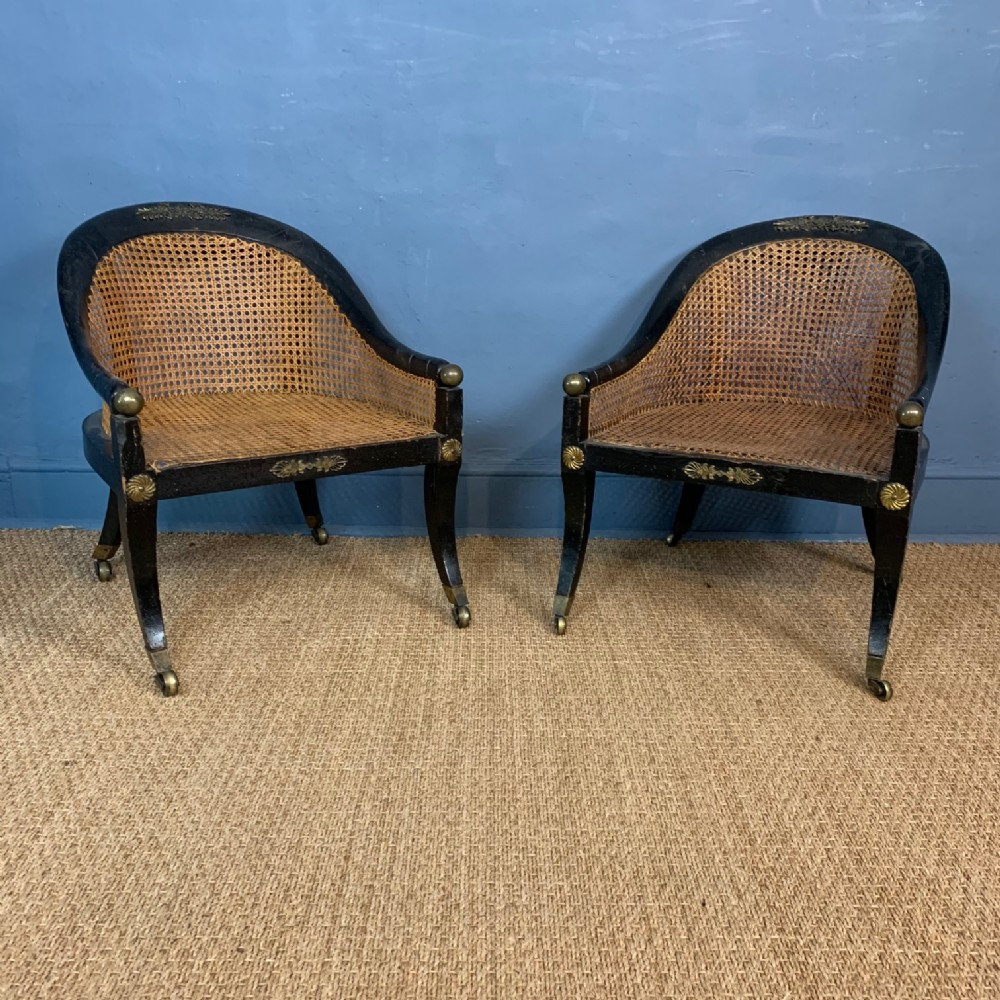 a rare pair of regency ebonised and cane low bergere chairs circa 1815
