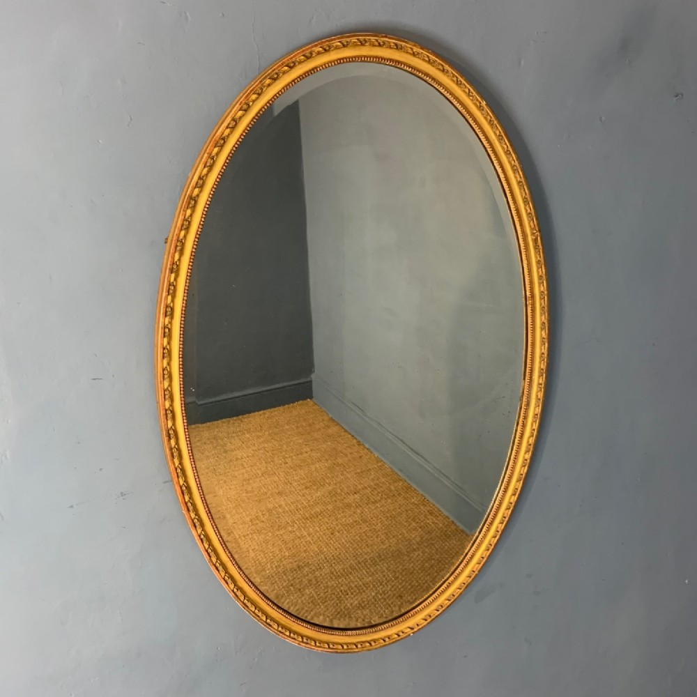 a large victorian oval mirror c 1880