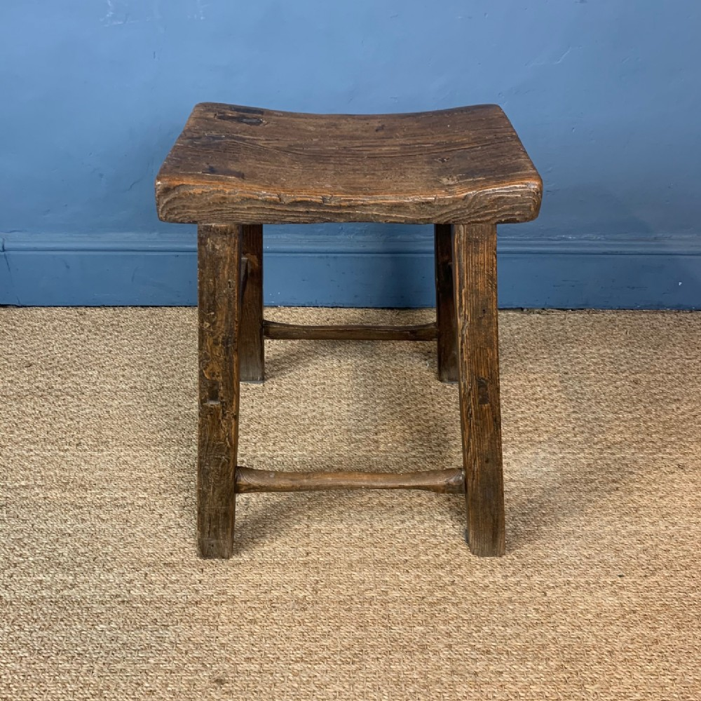 a 19th century elm stool with saddle top