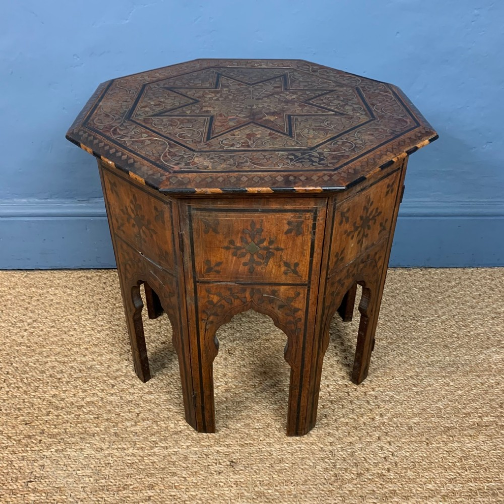 a hoshiarpur brass and ebony inlaid shisham wood octagonal table c 1890