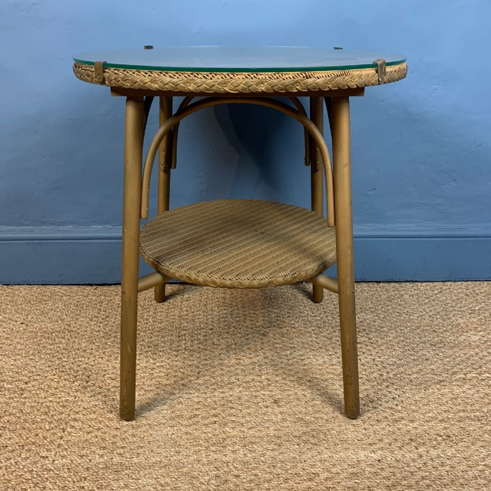 a 1930s lloyd loom 2 tier circular conservatory table with original glass top