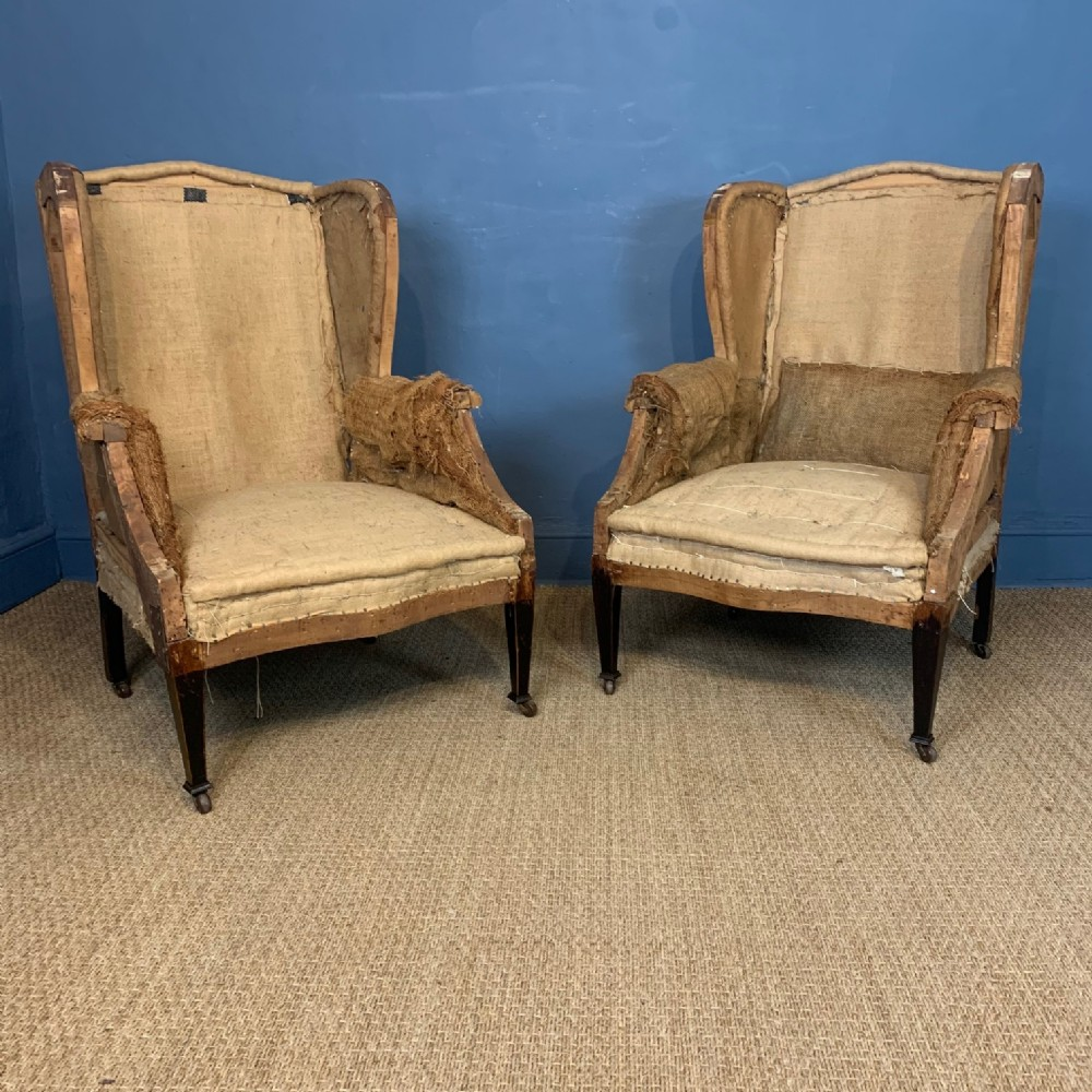 a pair of large edwardian wing armchairs c 1910