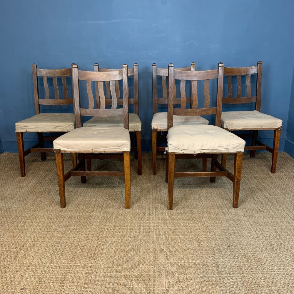 a set of six arts and crafts oak dining chairs circa 1900 in the style of cfa voysey