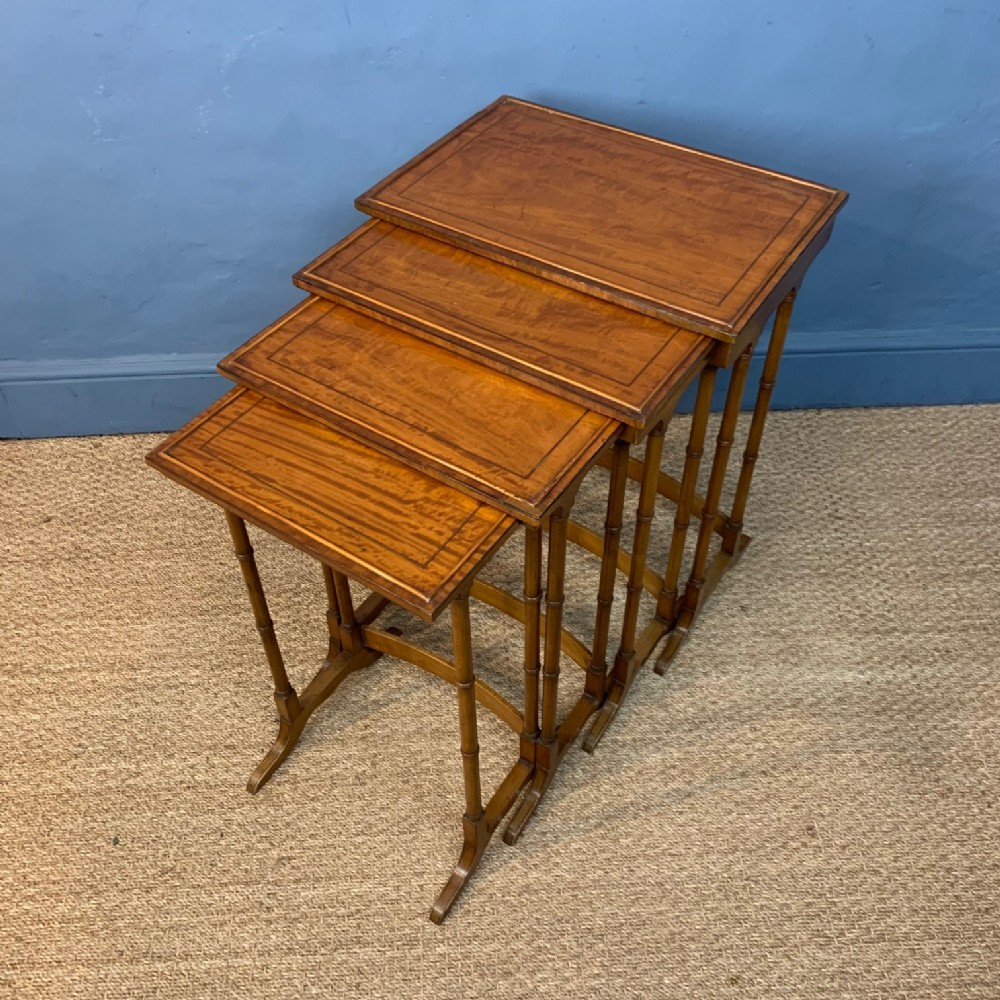 a nest of 4 edwardian satinwood tables circa 1910