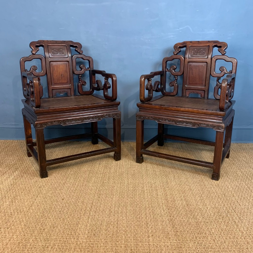 a pair of late 19th chinese elm throne chairs circa 1900