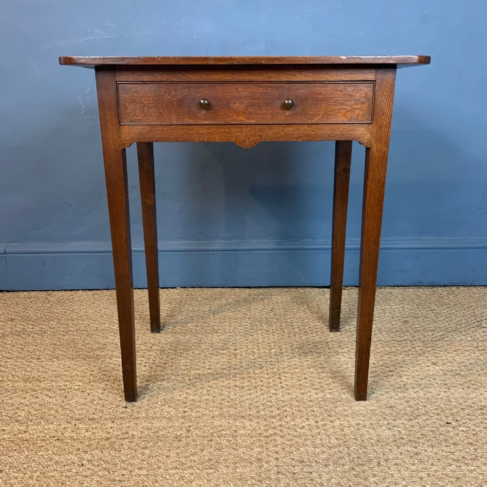a small george 111 oak provincial side table circa 1810