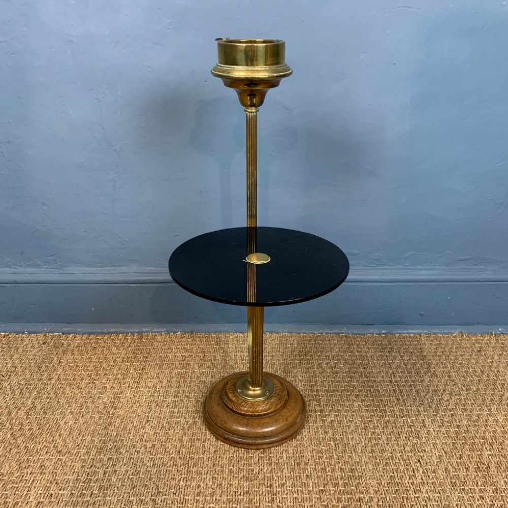an unusual edwardian brass and oak cigarette tray and drinks stand c 1910