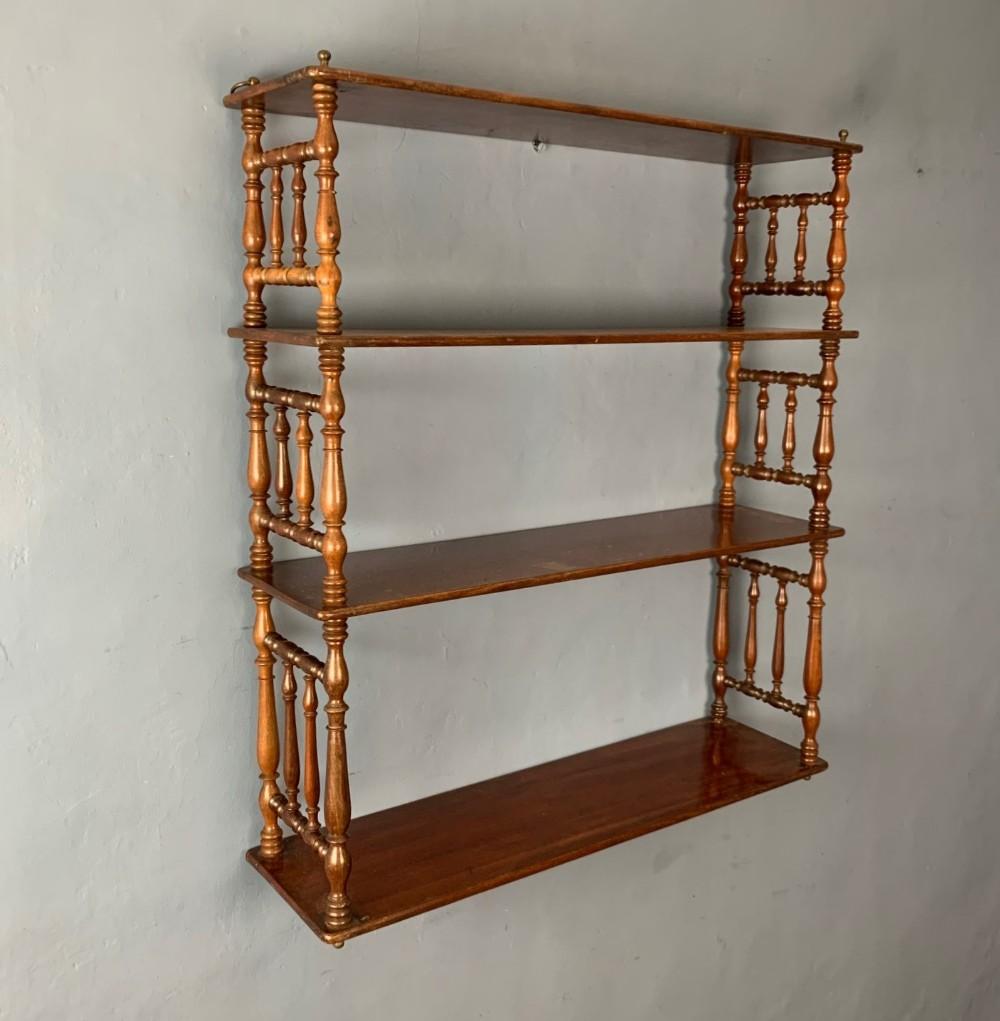 a set of early 19th century mahogany bobbin turned four tier wall shelves circa 1830