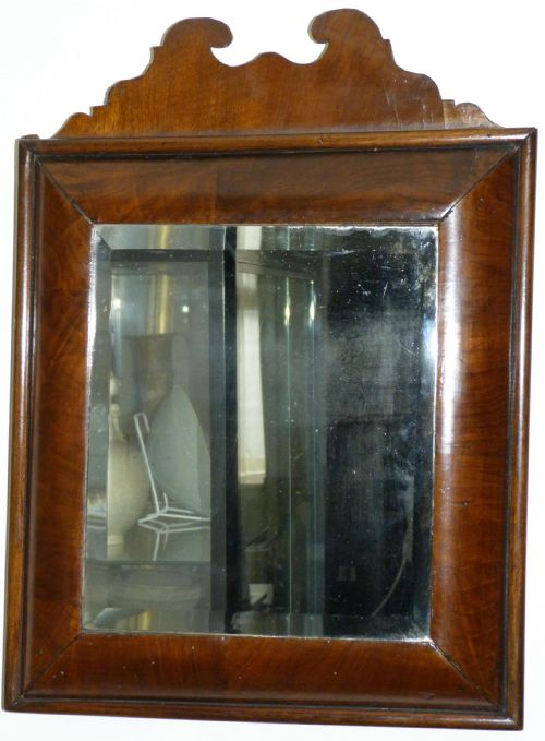 walnut cushion framed mirror c1690