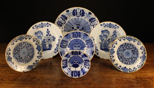 seven 18th century blue and white delft plates with yellow rims