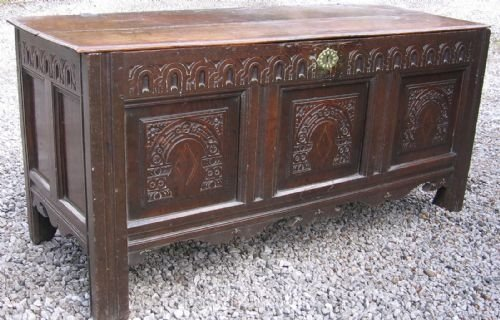 carved and inlaid oak coffer c1630