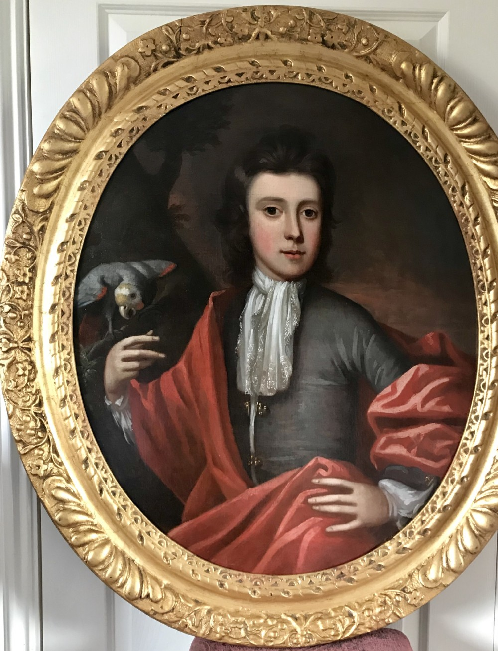 portrait of a boy and his parrot c1700 attributed to edward byng