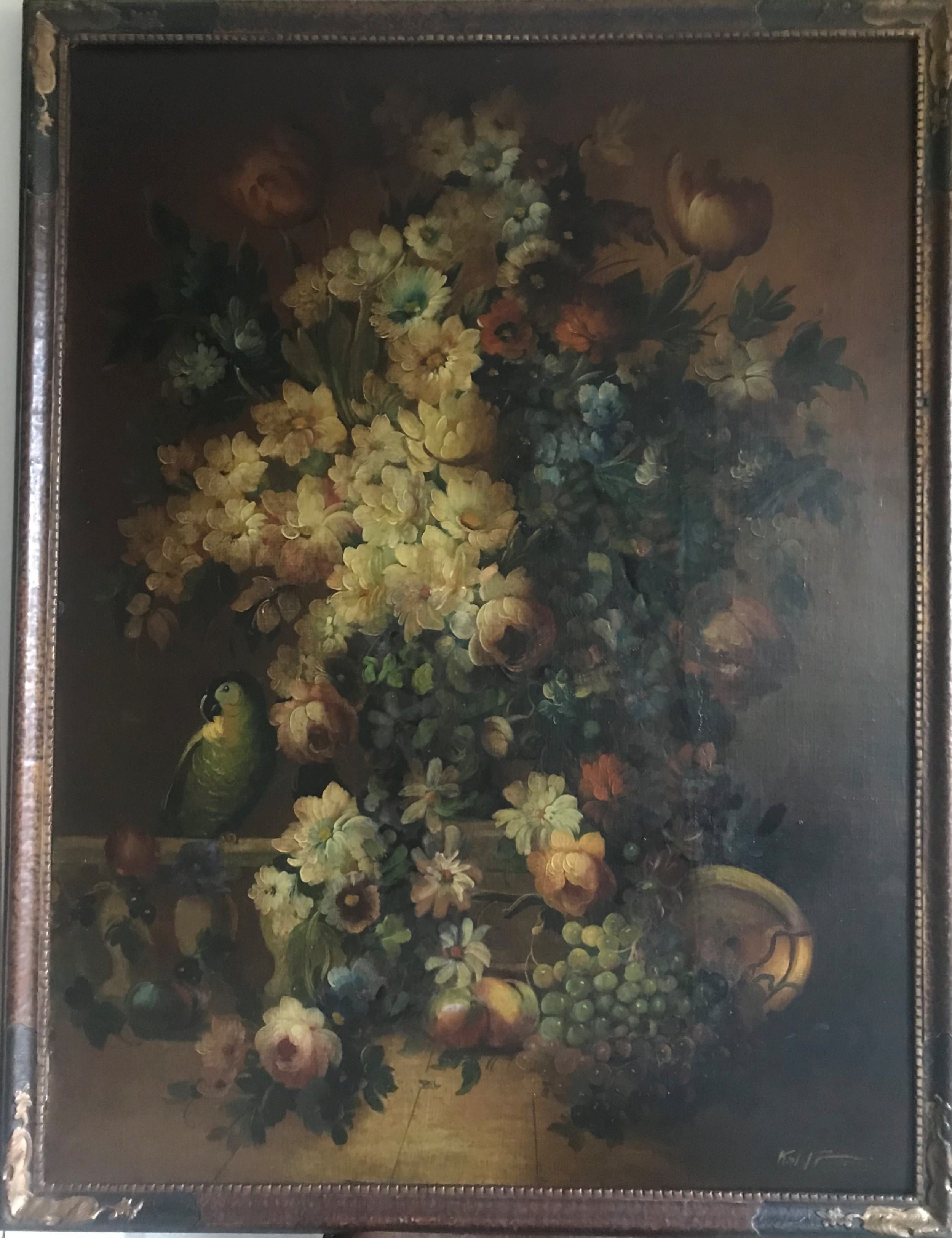 still life of fruit flowers and a parrot c18801910