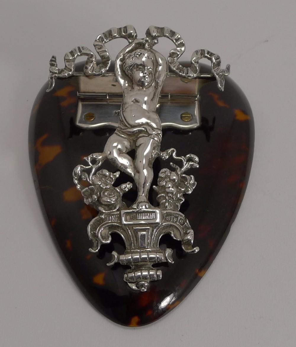 outstanding english sterling and tortoise shell letter clip heart cherub