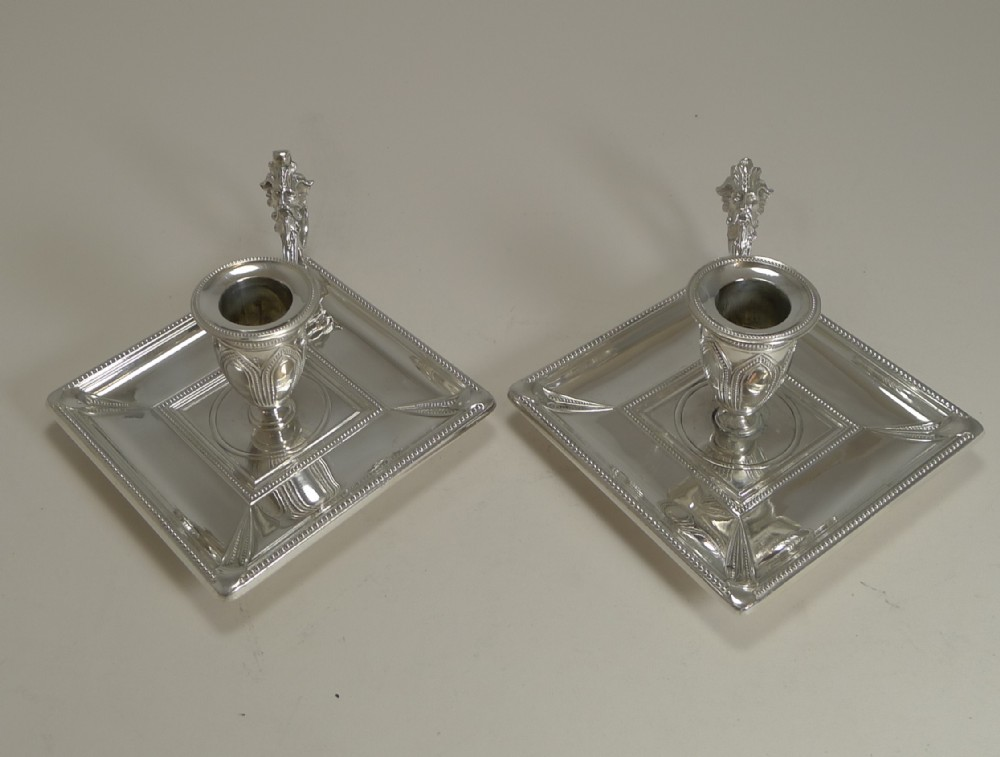 unusual pair antique english silver plate chamber sticks by james dixon and sons